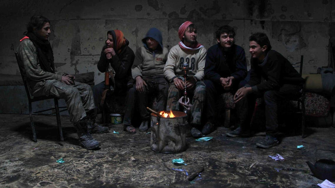 Rebel fighters rest inside a room at the old city of Aleppo near the frontline against forces loyal to Syria's President Bashar al-Assad December 28, 2014.