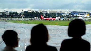 """تراجع أسهم الماليزية """"إير أيجا"""" 8% بعد مأساة الطائرة"""