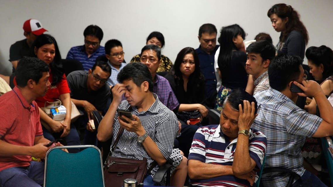 Family members of passengers onboard AirAsia flight QZ8501 react at a waiting area in Juanda International Airport, Surabaya December 28, 2014. (Reuters)