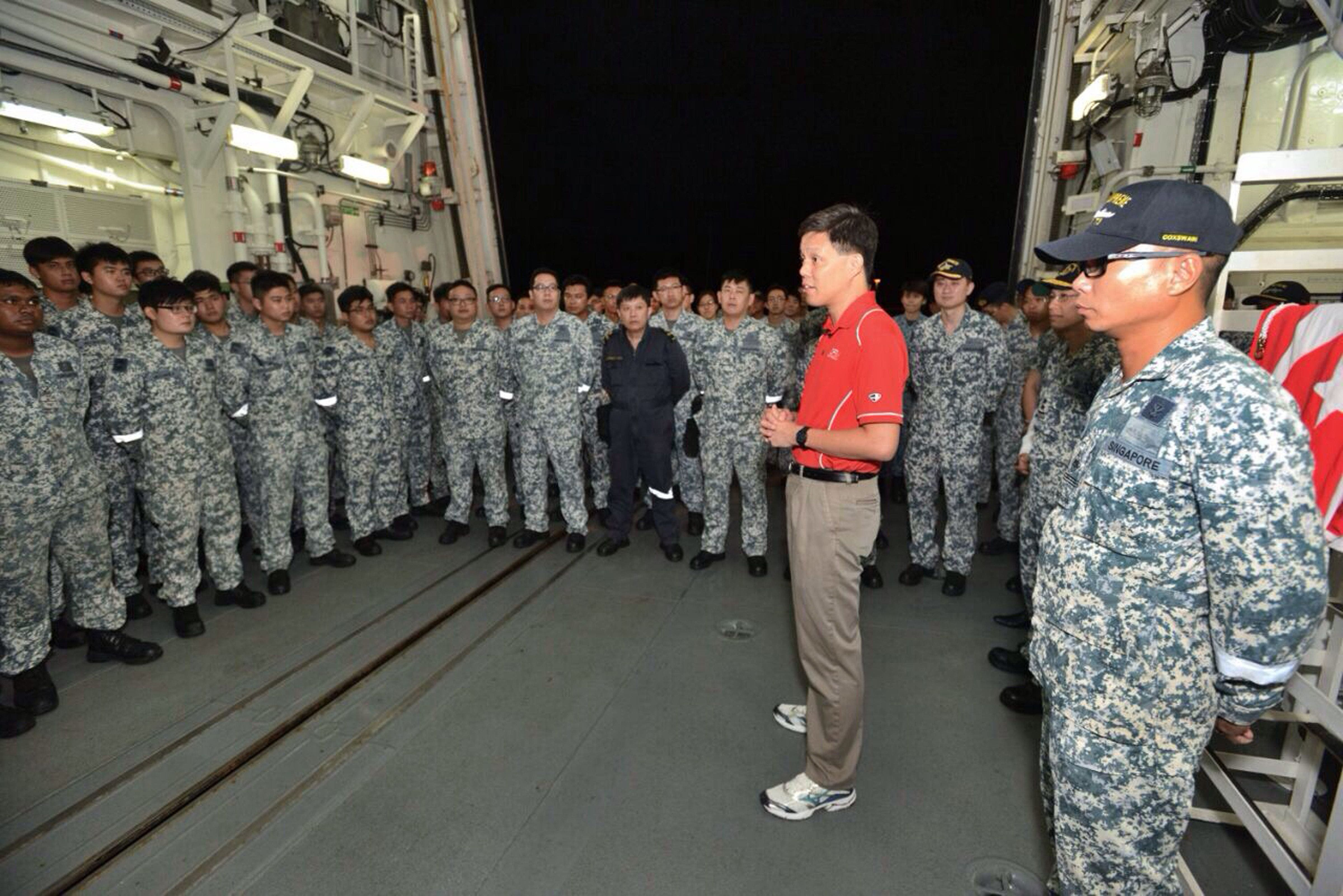 Second Minister for Defence Chan Chun Sing speaking with Republic of Singapore Navy (RSN) servicemen on board RSS Supreme before departing for Indonesia to take part in the search operation. (AFP)
