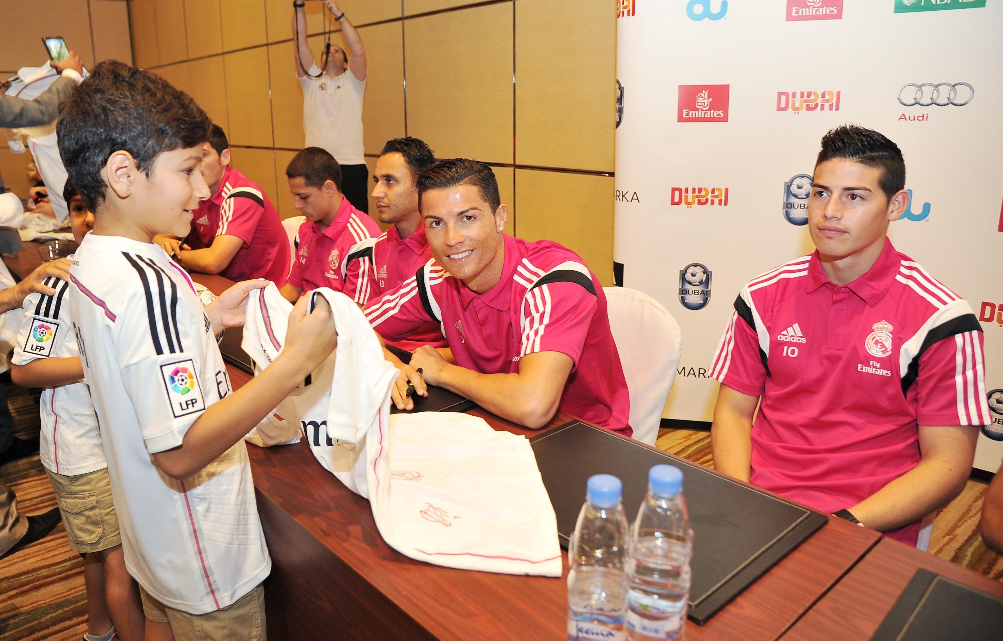 Real Madrid star forward Cristiano Ronaldo seen with a young fan. (Emirates)