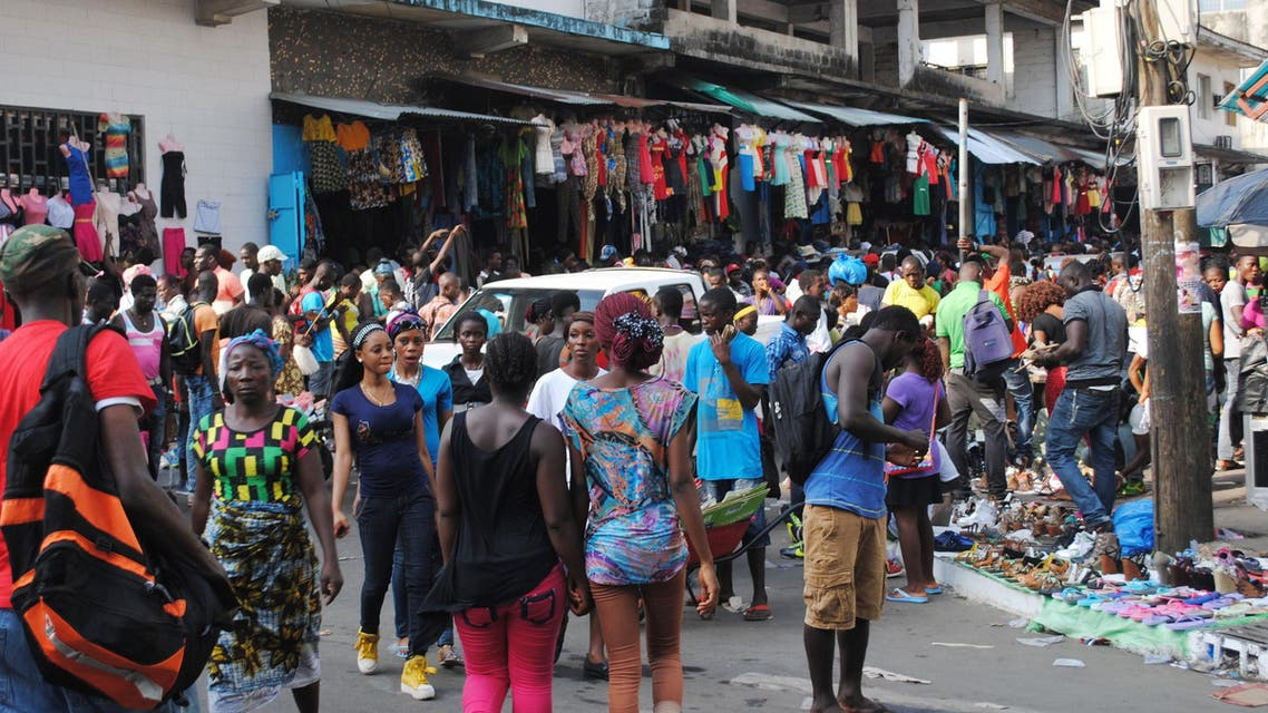 People walk in a market on December 24, 2014 in Monrovia.  (AFP)