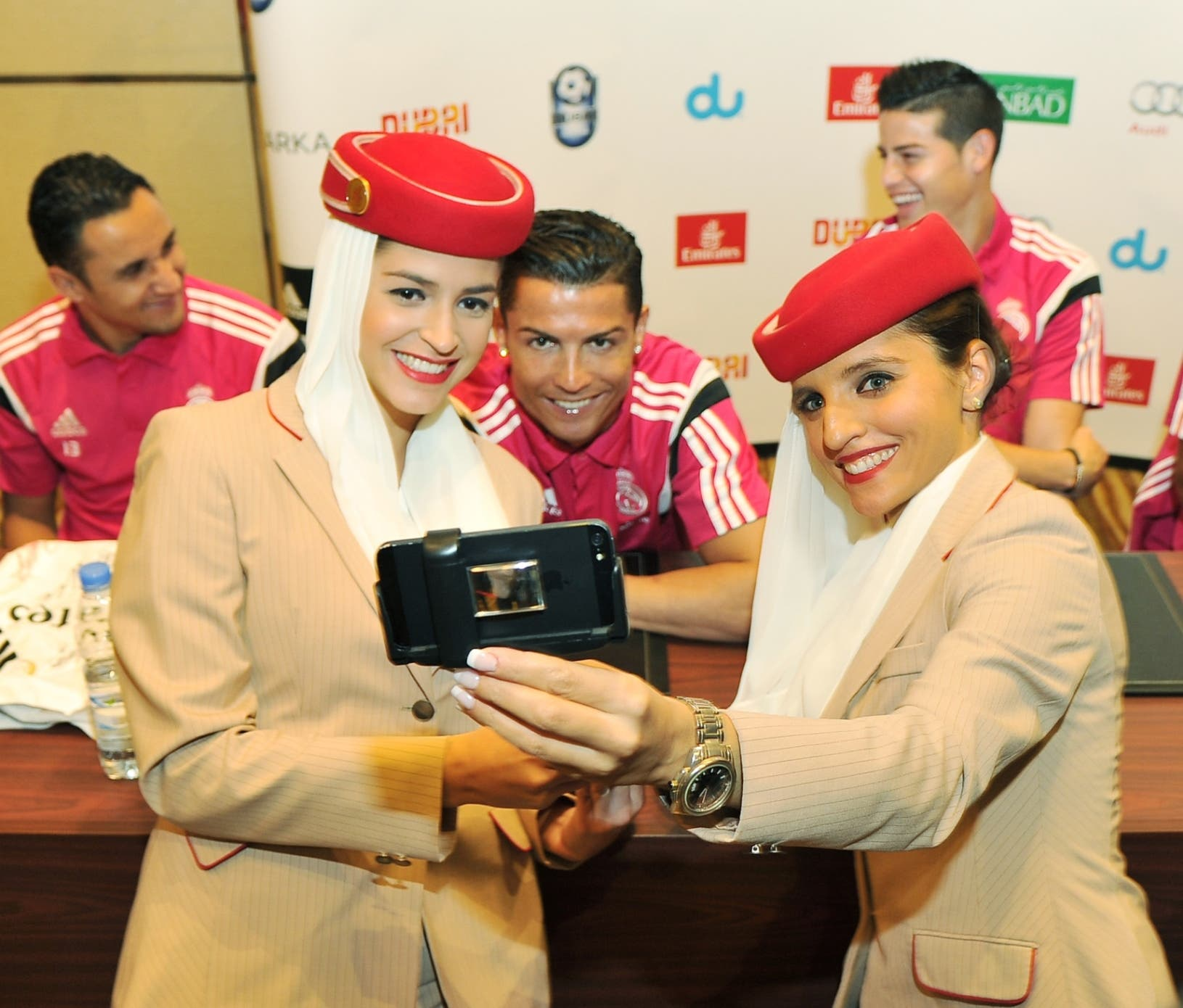 Emirates airline cabin crew pose for a photo with Real Madrid star forward Cristiano Ronaldo (Emirates)