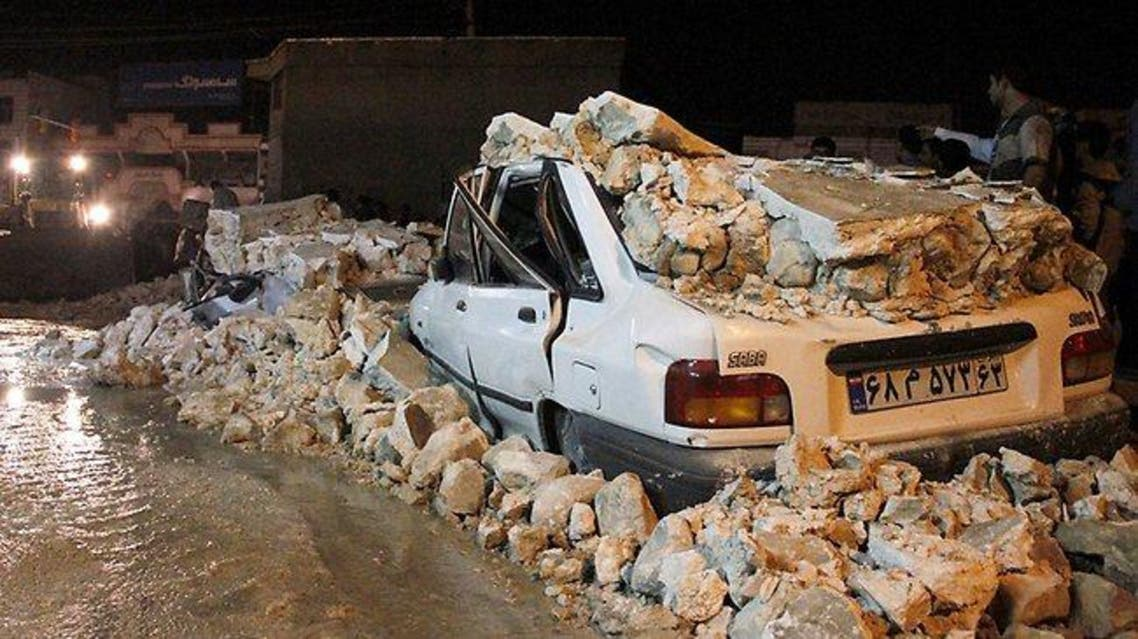 A wrecked car lies amid rubble after an earthquake struck the Iranian city of Borazjan in 2013. Picture: AFP Source: AFP