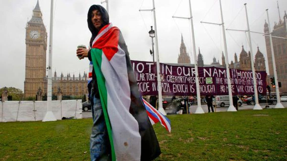 Man wearing Palestinian flag in London reuters