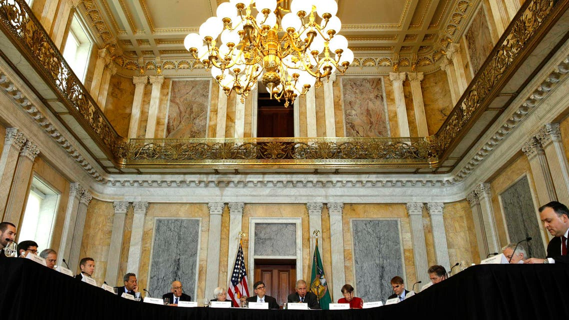 Treasury Secretary Jack Lew (C) hosts an open session meeting of the Financial Stability Oversight Council in the Cash Room of the Treasury in Washington Dec. 18, 2014. (Reuters)