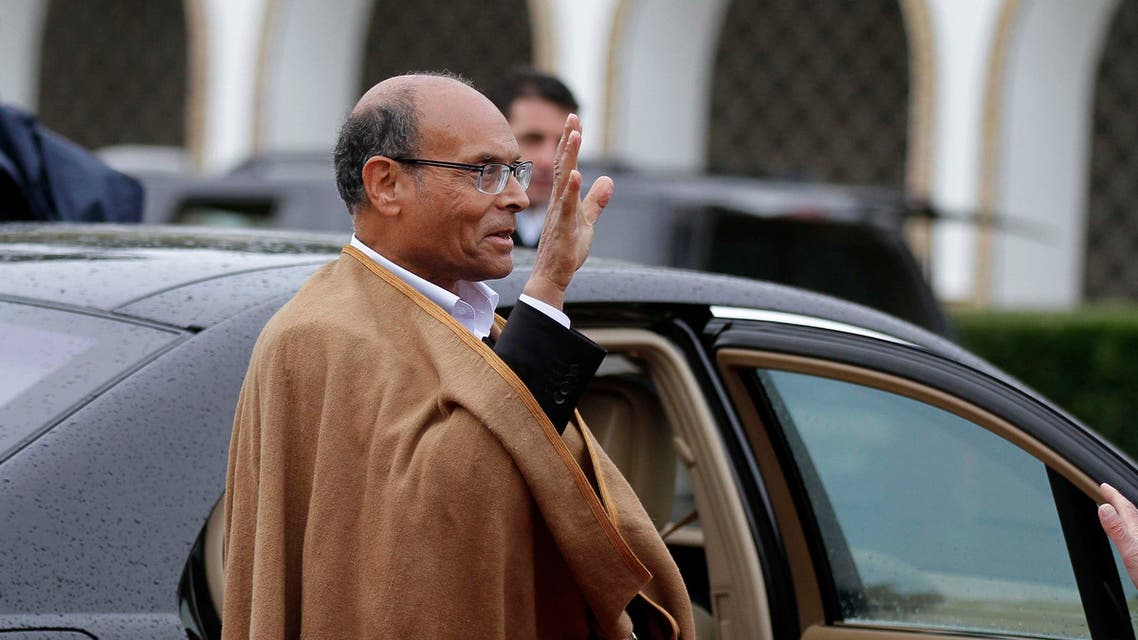 Tunisia's outgoing interim President Moncef Marzouki waves as he leaves the Carthage Palace in Tunis December 31, 2014. REUTERS