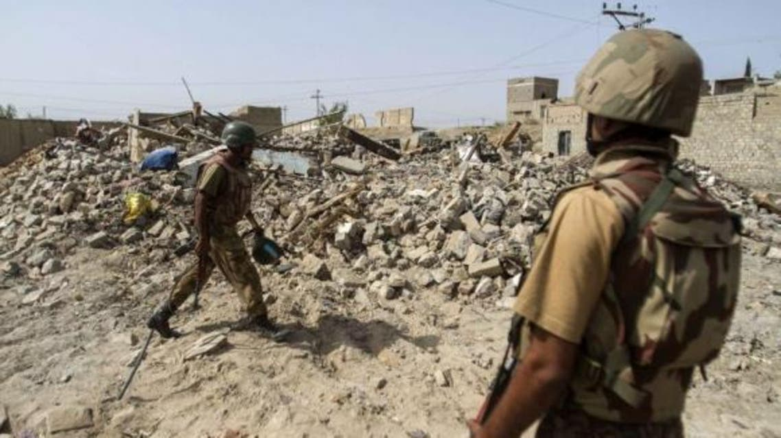 Pakistani soldiers stand near the debris of a house which was destroyed during a military operation against Taliban militants in the town of Miranshah in North Waziristan July 9, 2014. (File Photo: Reuters)