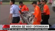 Official denies AirAsia victim was wearing life jacket