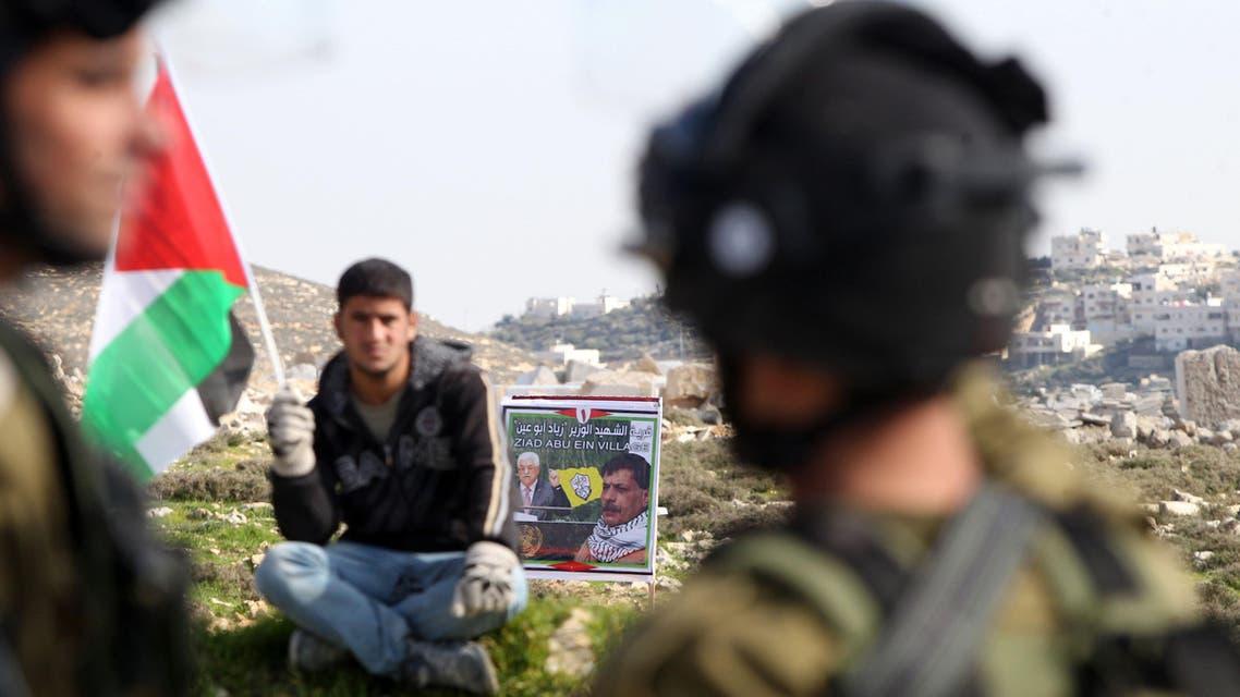 Palestinian man Israeli soldiers AFP