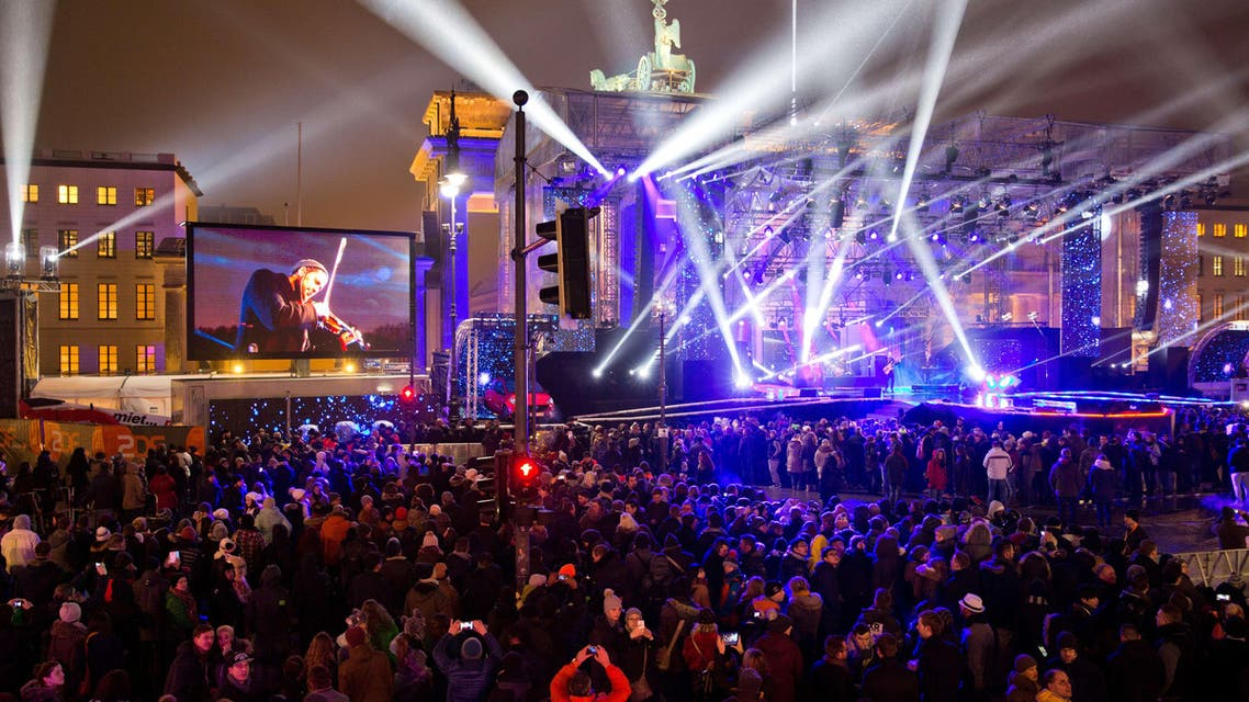 People attend the New Year's eve party at Berlin's landmark Brandenburg Gate on December 31, 2014. AFP