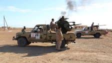 Militants, guards clash near Libya's Brega port, oil commander wounded