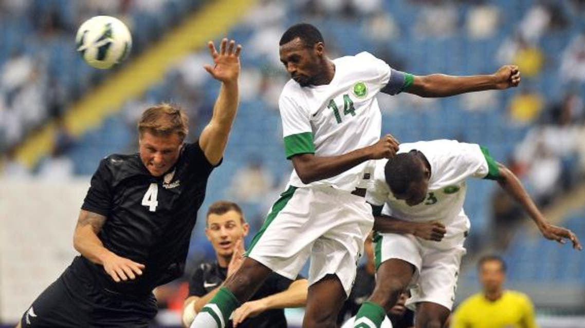 Saudi Arabia's player Saud Kariri  defends against New Zealand's national team player Ben Sigmund (L) during their international friendly football match at the King Fahad stadium in 2013. (File photo: AFP)