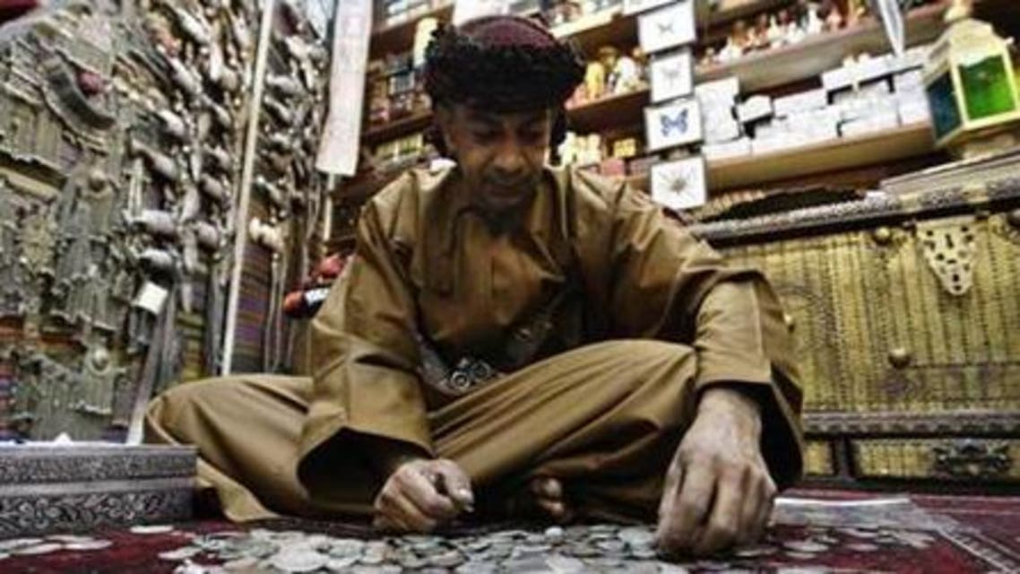 An Omani man sits in his antiques shop in Mattrah Souq, the oldest market in Oman, in the capital Muscat. (File photo Reuters)