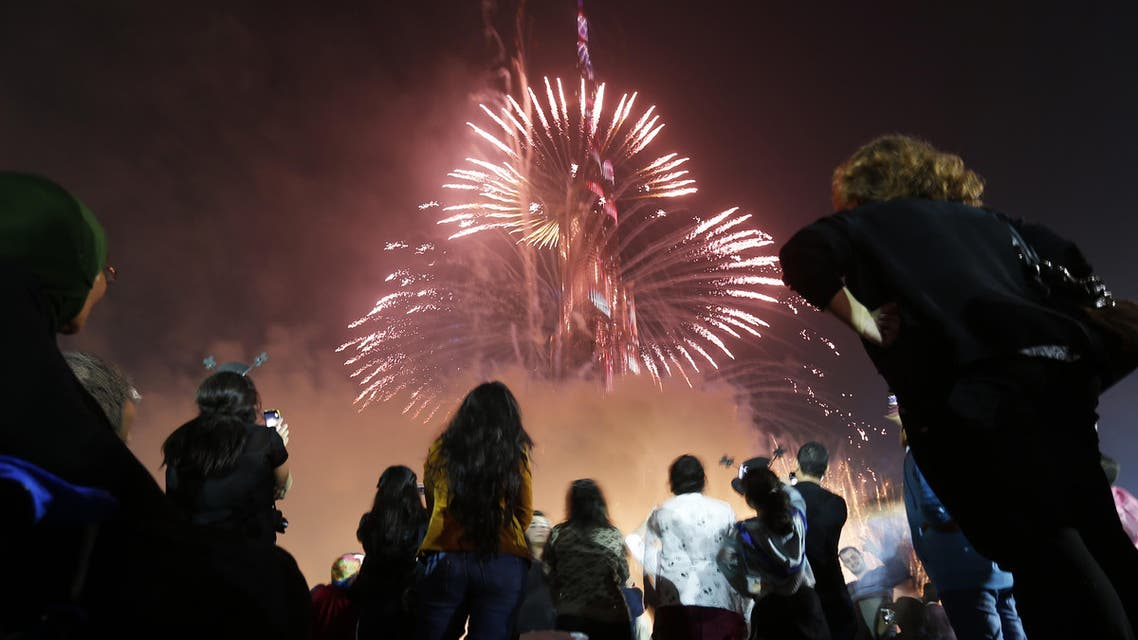 : People look at a firework display during a New Year celebration on January 1, 2015 in Dubai. (AFP)