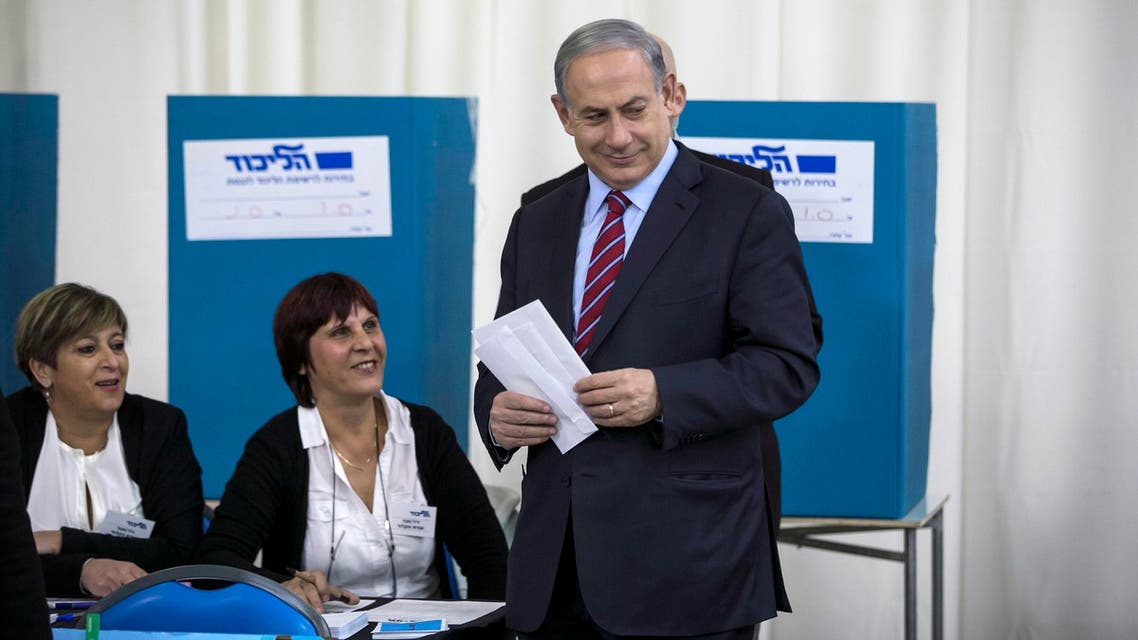 Israel's Prime Minister Benjamin Netanyahu (R) casts his ballot for the Likud primary at a polling station in Jerusalem December 31, 2014. (Reuters)