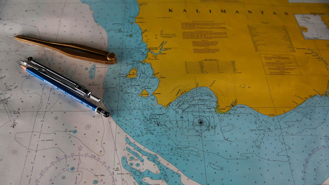 """A map with the mark """"TKP"""" (C), believed to indicate the possible location of the wreckage of AirAsia flight QZ8501, is seen onboard SAR ship Purworejo at Kumai port, Pangkalan Bun district, January 1, 2015. reuters"""