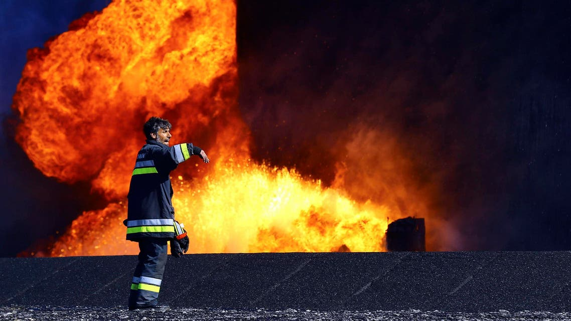 Libya al-sidr ed-sidr oil fire reuters fire fighter