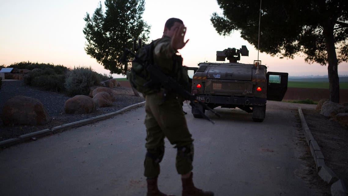 An Israeli soldier gestures during a patrol near Kibbutz Mefalsim, just outside the northern Gaza Strip December 24, 2014. (Reuters)2