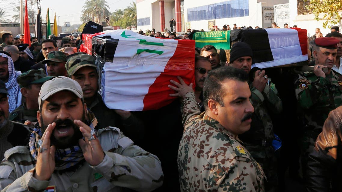 Mourners attend the funerals of two senior Shi'ite militia commanders who were killed fighting Islamic State militants in Baghdad, December 30, 2014. reuters