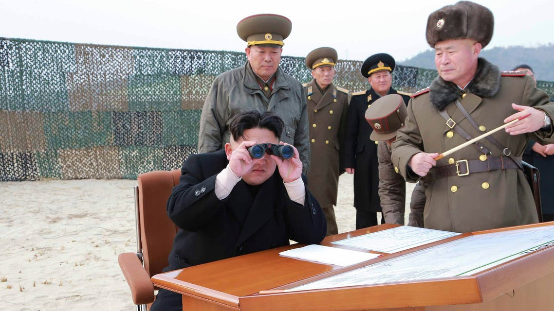 North Korean leader Kim Jong Un looks through a pair of binoculars as he guides the multiple-rocket launching drill of women's sub-units under KPA Unit 851, in this undated photo released by North Korea's Korean Central News Agency (KCNA) in Pyongyang December 30, 2014. (Reuters)
