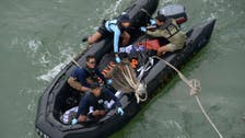 Indonesia sends divers to examine AirAsia wreckage