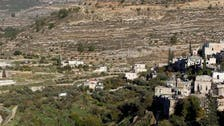 Israel says barrier to spare ancient Palestinian village