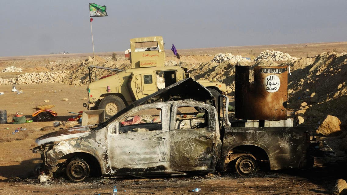 A damaged vehicle belonging to the Islamic State militants is seen on the outskirt of Ramadi December 21, 2014. (Reuters)