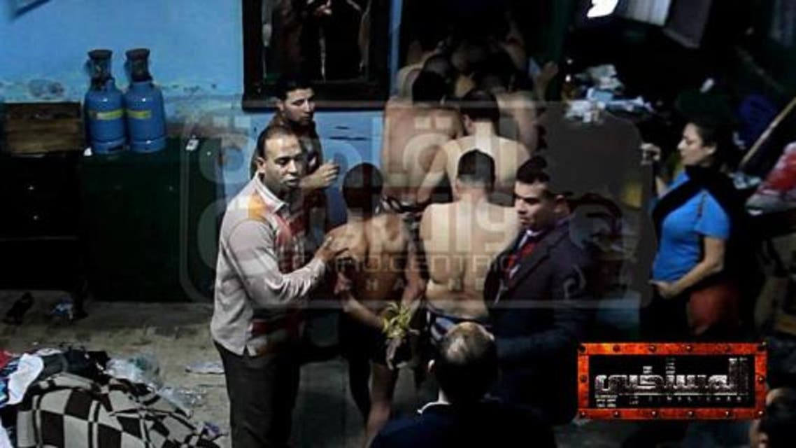 Men seen being arrested at the bathhouse, at this photo which surfaced on social media. (Photo courtesy of Facebook)