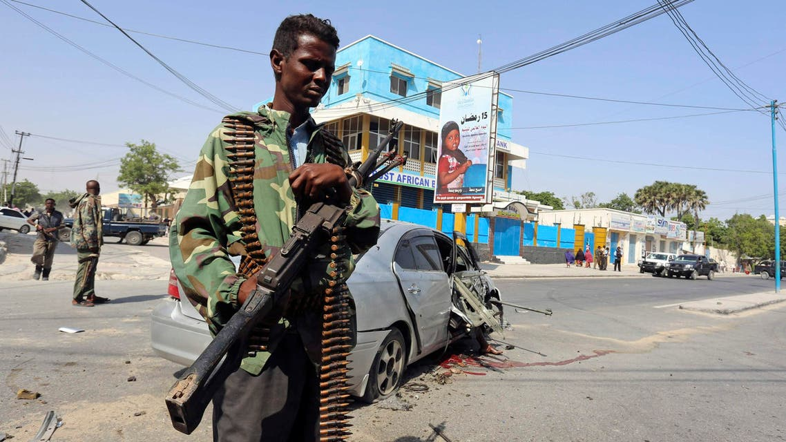 A policeman secures the scene of a car bomb explosion near the Taleex junction of Somalia's capital Mogadishu, January 2, 2015. (Reuters)