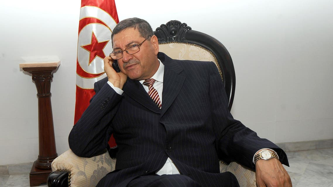 A file picture taken on April 5, 2011 shows Tunisian ex-interior minister Habib Essid making a phone call before meeting with his Italian counterpart in Tunis. (AFP)