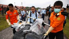 Indonesia naval captain says may have located missing plane's tail