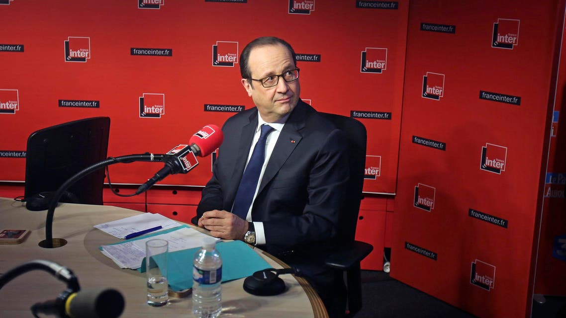 French President Francois Hollande prepares to answer journalists during a live interview at the France Inter radio station studios in Paris Jan. 5, 2015. (Reuters)