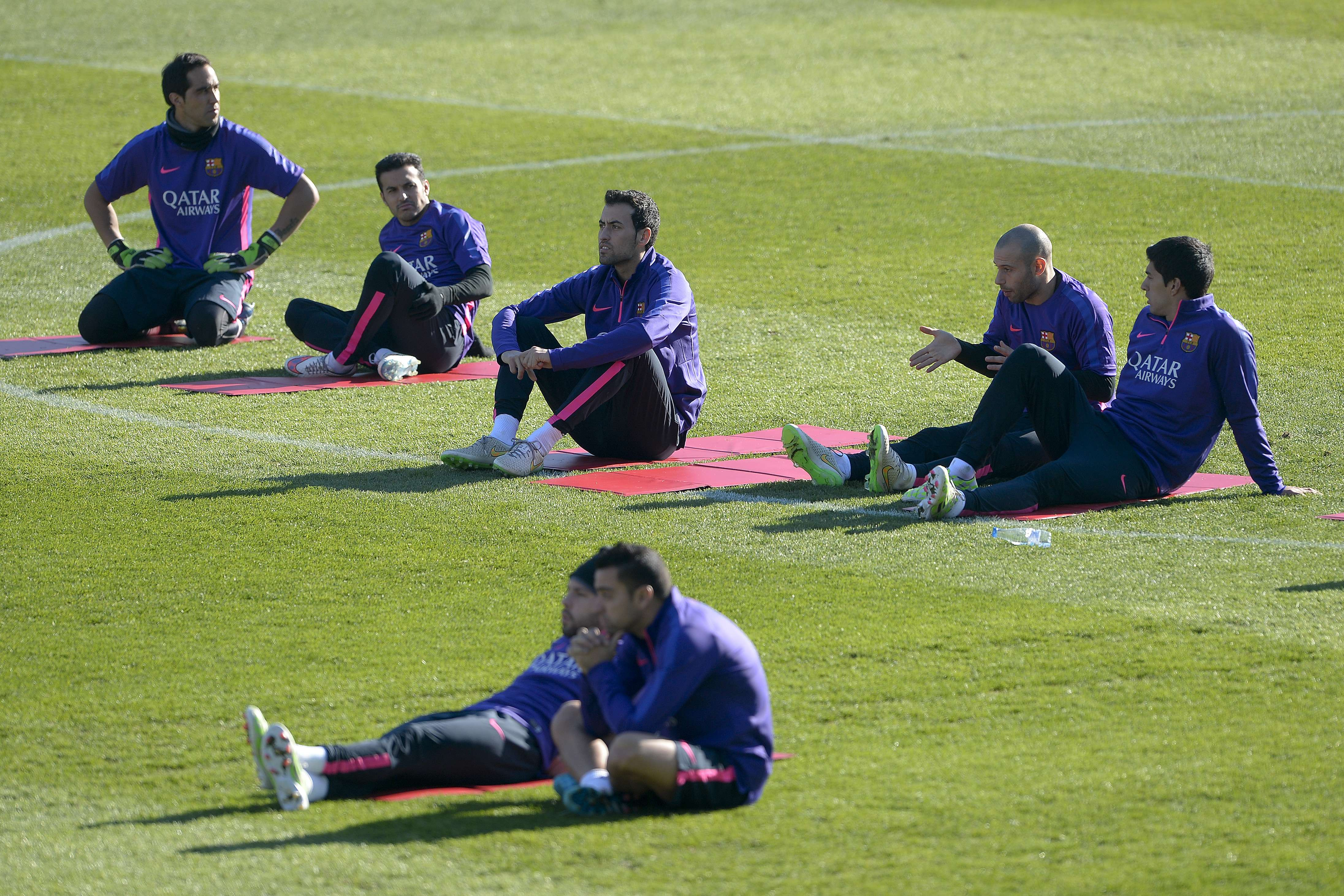 Barcelona's players take part in an open training session at the Mini Stadium in Barcelona on Jan.  5, 2015. (AFP)