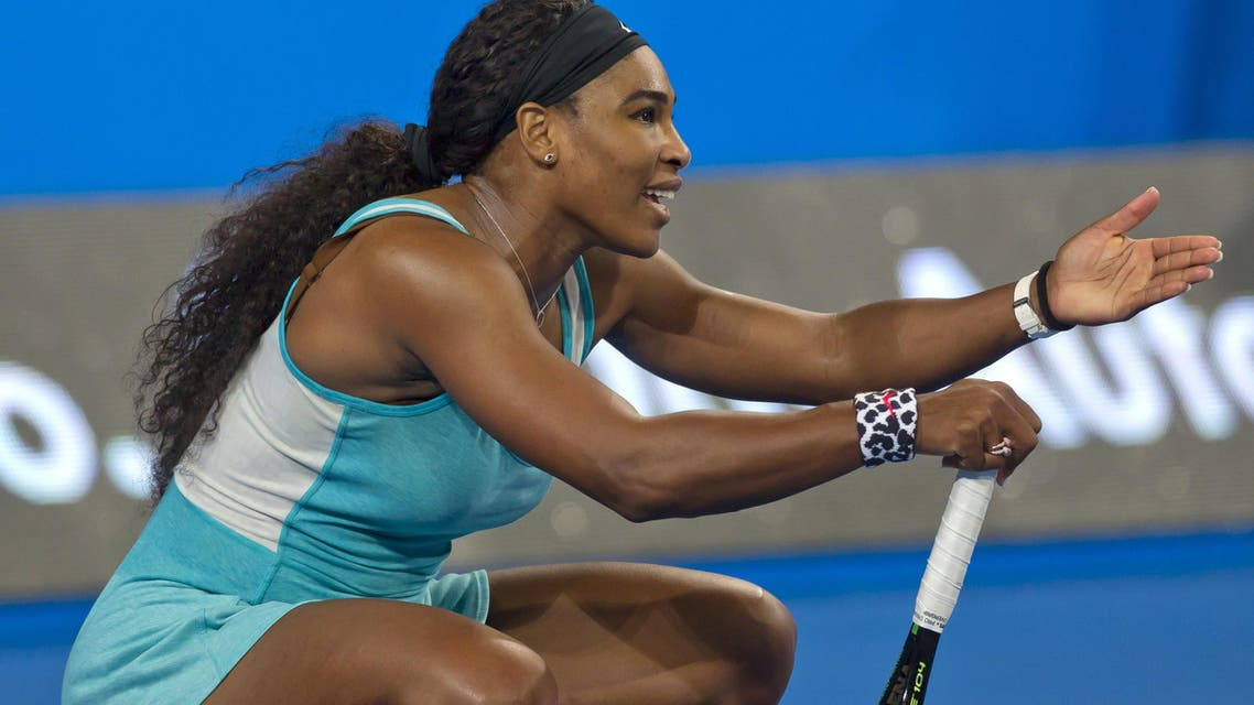 Serena Williams of the US gestures while playing against Flavia Pennetta of Italy during their third session women's singles match on day two of the Hopman Cup tennis tournament in Perth on January 5, 2015. AFP
