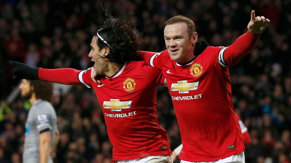 Manchester United's Wayne Rooney (R) celebrates after scoring a goal against Newcastle with team-mate Radamel Falcao during their English Premier League soccer match at Old Trafford in Manchester, northern England Dec. 26, 2014. (Reuters)