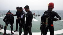 Divers join AirAsia wreck hunt, but no sign of black box
