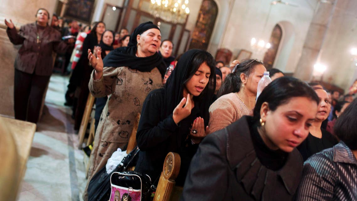Coptic Orthodox Christian pray during a religious session by father Makary at St Mark Cathedral in Cairo December 26, 2014. Reuters