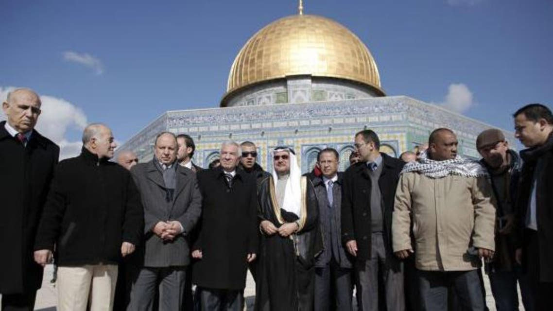 Iyad bin Amin Madani, secretary general of the Organization of Islamic Cooperation (C) walks outside Jerusalem's Dome of the Rock during his visit to the Temple Mount on Jan. 5, 2015. (photo credit: AFP )
