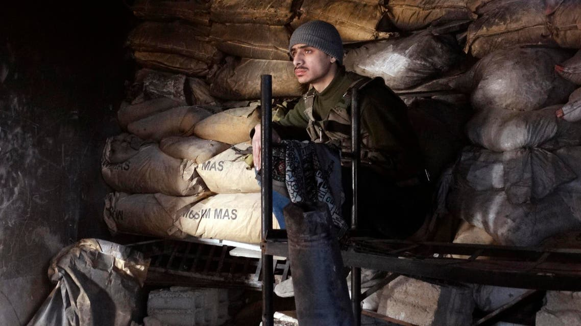 A Free Syrian Army fighter sits behind sandbags in Jobar, a suburb of Damascus Jan. 4, 2015.  (Reuters)