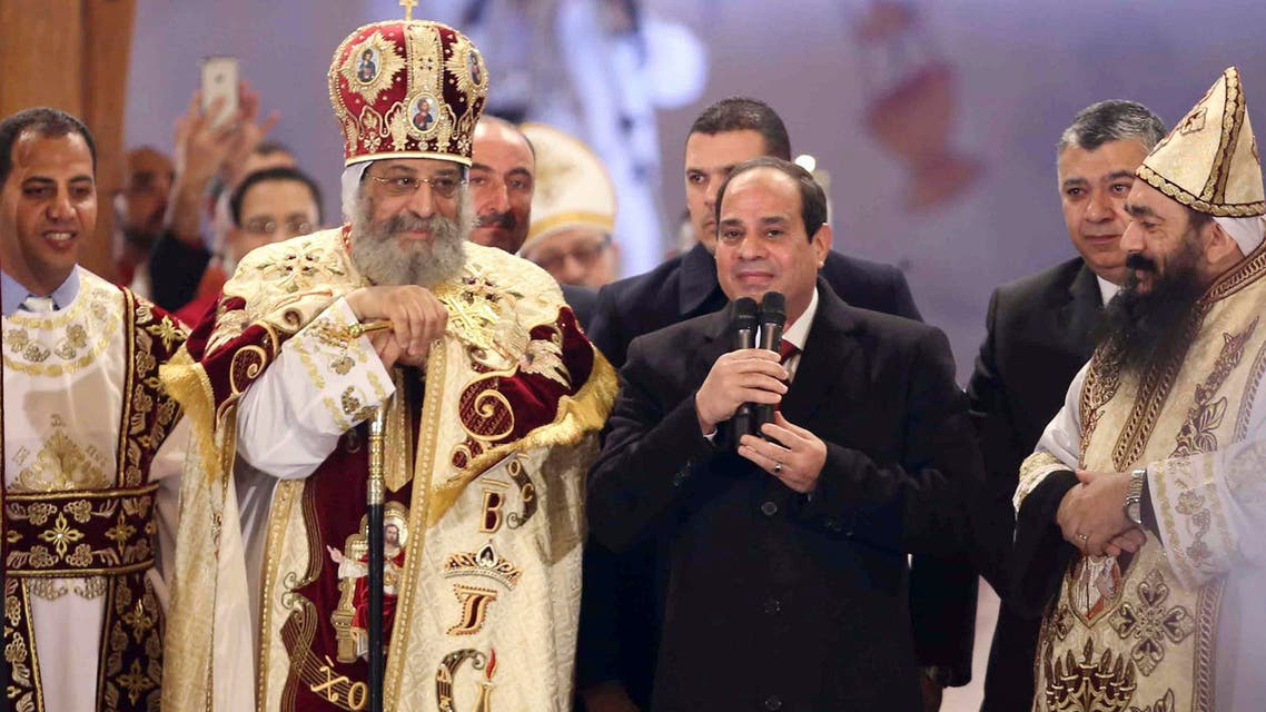 Egyptian President Abdel Fattah al-Sisi (2nd R) talks next to Coptic Pope Tawadros II as he attends Christmas Eve Mass at St. Mark's Cathedral. (Reuters)