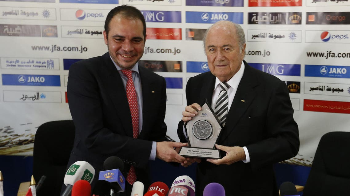 FIFA President Sepp Blatter and Jordan's Prince Ali Bin Al Hussein, FIFA's vice president Asia, chairman of the Jordan Football Association, sign a ball after their a joint news conference in Amman in this May 26, 2014 file photo Reuters