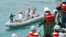 Indonesia says crashed AirAsia plane tail found