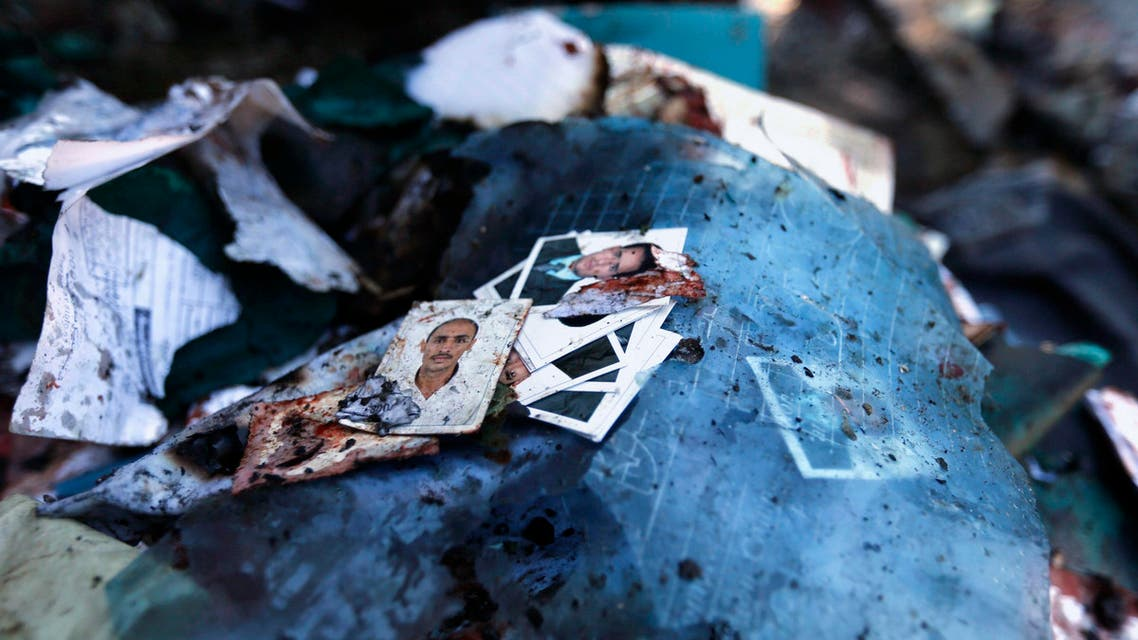 Photos are pictured on the ground at the scene of a car bomb attack the police college in Sanaa January 7, 2015. (Reuters)