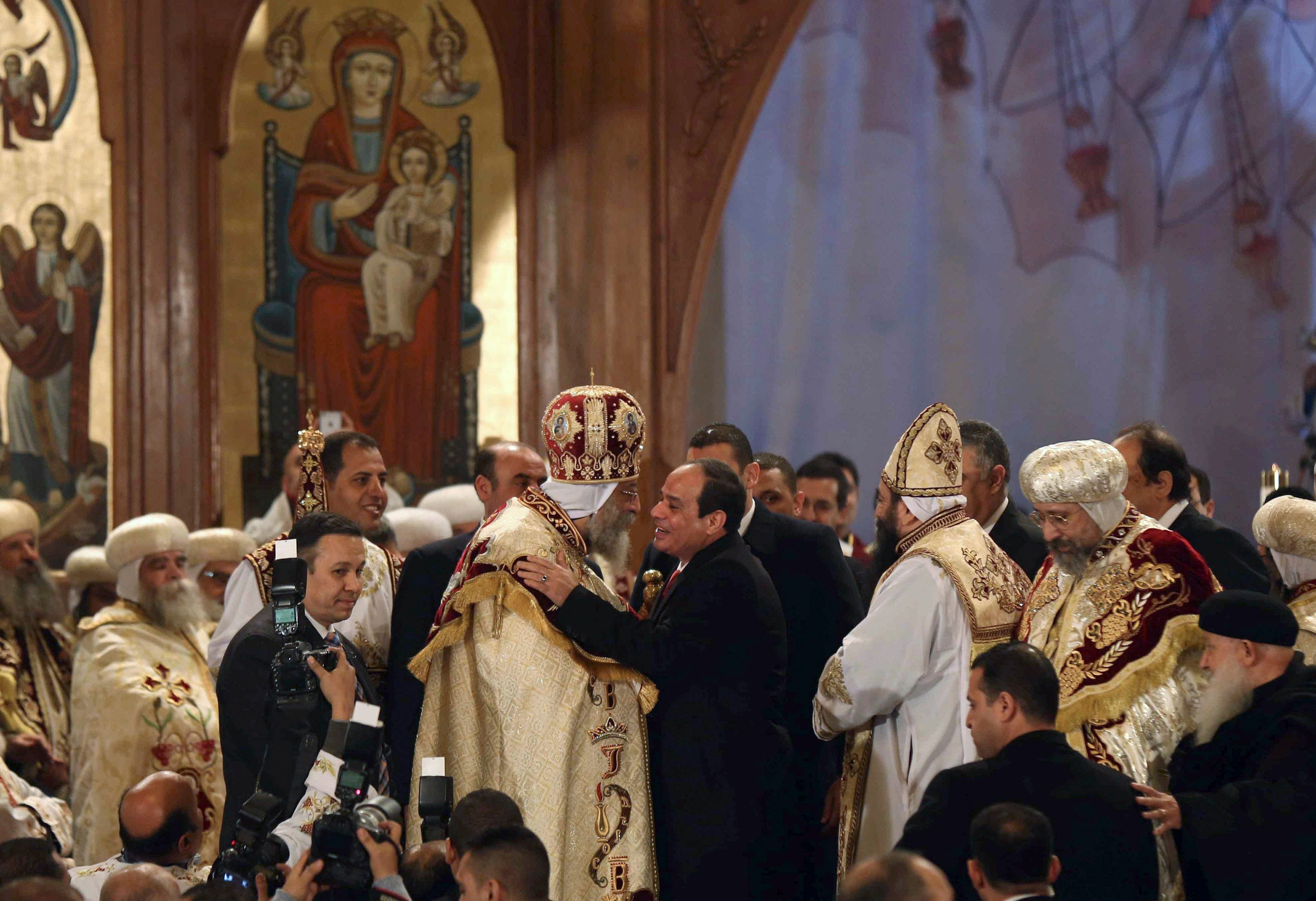 Egyptian President Abdel Fattah al-Sisi (centre R) greets Coptic Pope Tawadros II as he attends Christmas Eve Mass at at St. Mark's Cathedral, the seat of the Coptic Orthodox Pope, in Cairo January 6, 2015. REUTERS