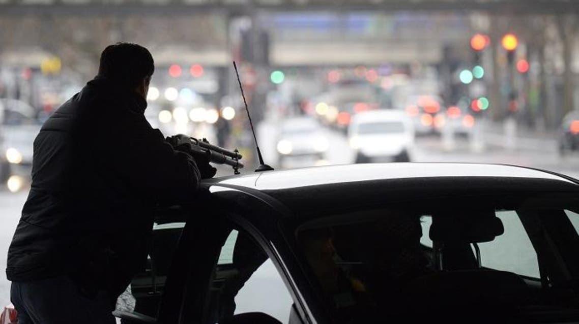 A police officer mans a position at the Porte de la Villette road hub in Paris on Jan. 8, 2015. (AFP)