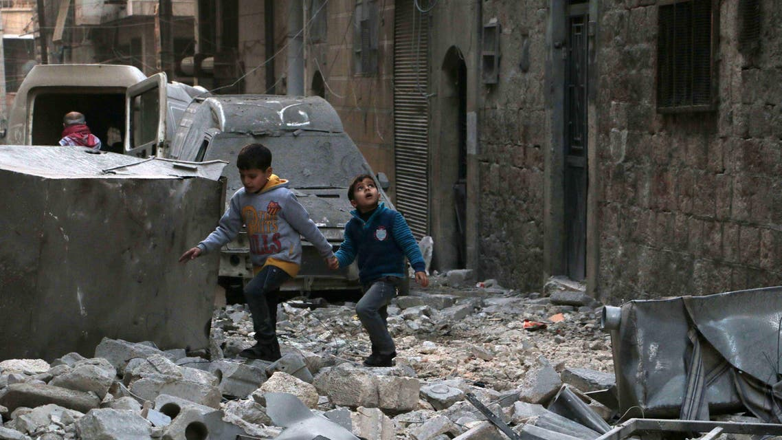 Children make their way through the rubble of buildings in a devastated street on January 1, 2015 in the al-Kalasa neighbourhood of the northern Syrian city of Aleppo. ( File photo: AFP)