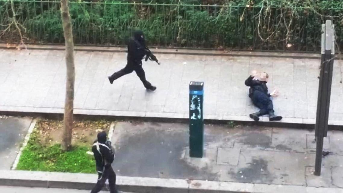 One of the gunmen shoots a police officer, believed to be Ahmed Merabet, at a close range. (Photo courtesy: YouTube)
