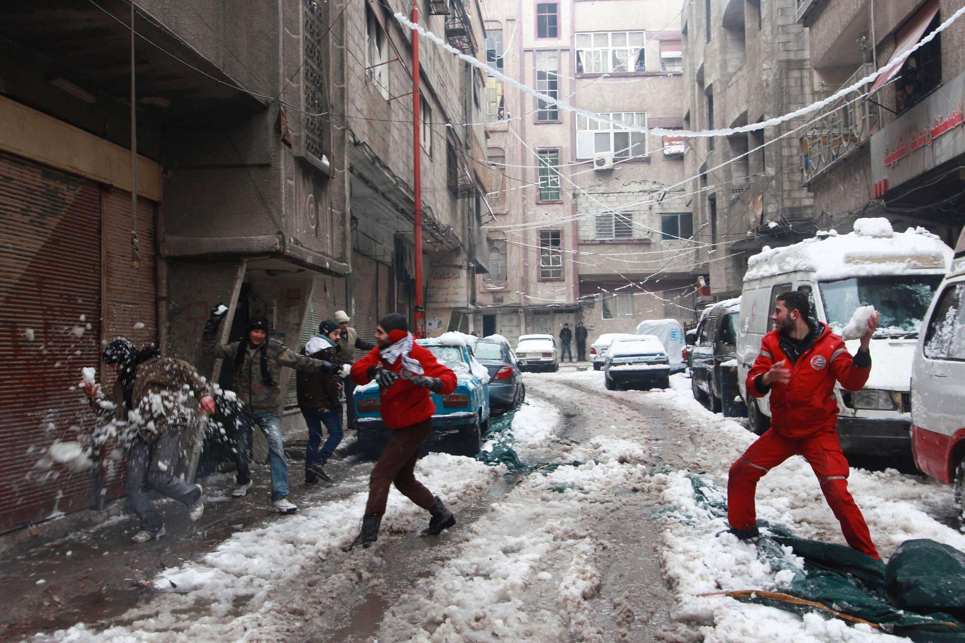 Snow brings some joy to Syrians