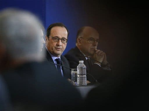 French President Francois Hollande addresses the media with prime minister Manuel Valls, left, and interior minister Bernard Cazeneuve at the Interior Ministry, in Paris, Friday Jan. 9, 2015. (AP)